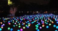 put glow sticks in a balloon and put them all over your yard