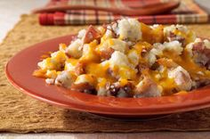 Roasted garlic and shredded cheddar cheese give these potatoes their big flavor. Keep things easy (and colorful!) by leaving the skins on the red potatoes.