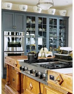 kitchen-of-the-month-house-beautiful-magazine-c-gridley-graves-photogrpahy-french-country-kitchen-on-nantucket-ceramic-english-milk-pails-1…