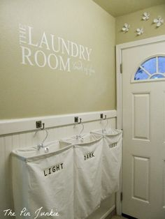 These laundry sorters are so pretty on their simple hooks.  - 20 Genius DIY Laundry Room Organization Ideas - DIY for Life