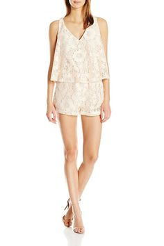86dd184cb77 This classy romper will keep them guessing. It is partially lined and has a  sheer. Shoptiques
