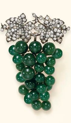 AN ANTIQUE DIAMOND AND GREEN CHALCEDONY BROOCH  Designed as a cluster of vari-sized green chalcedony grapes, suspended by old European and old mine-cut diamond leaves and stem, mounted in silver and gold, circa 1895, in a red leather case
