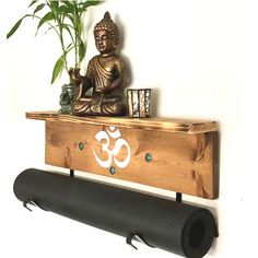 https://www.yogamatholders.com  Why is your beautiful yoga mat sitting on the floor? Hang it up on this handmade, wall mountable mat holder. #tribal #turtlesandyoga #yogagifts