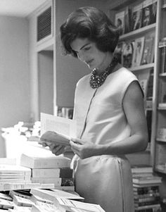 "mrs-kennedy-and-me: "" Jackie looking over the new White House guide books, in which she had made to raise money for the White House Restoration, and which we still use today at the White House. """