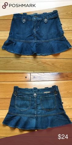"Juicy Couture Mini Denim Skirt Very good condition, Denim Mini Skirt with flirty Flare at bottom. Zipper fly with button closure. 100% cotton. When flat, waist measures about 15"" across; top to bottom is about 13 1/4"" Juicy Couture Skirts Circle & Skater"