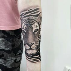 Tiger tattoo arm