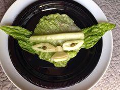 YODA from STAR WARS: Head/Ears: Romaine Lettuce Mouth, Nose, Eyes, Eyebrow: Ridge of the Romaine Lettuce Eyeballs: Capers