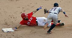 Rougned Odor slides by Jose Altuve as he steals second during the seventh inning of Texas' 12-4 win Saturday, September 3, 2016 at Globe Life Park in Arlington. (G.J. McCarthy/The Dallas Morning News)