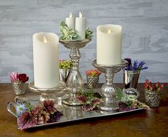 Our mercury glass collection and metal trays make our Luminara candles the center of an elegant and classy display.