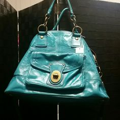 Rare Coach (Francine)  handbag Turquoise Turquoise patent leather coach bag stylish with front toggle, gold tone hardware, 2 top handles and long strap, large rear outside pocket, fully lined in striped satin fabric, barely used. Coach Bags Shoulder Bags