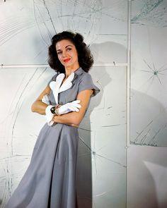 Carol Bruce Modeling a Gray Dress