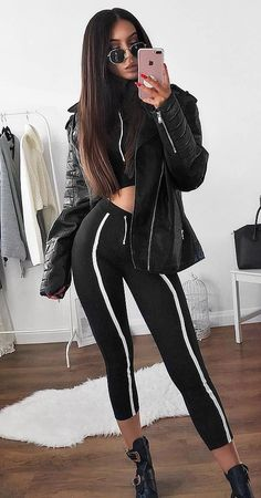 all black everything / jacket + stripped pants + boots + top