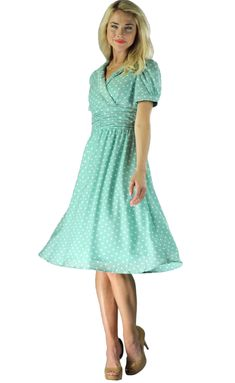 """This dress features a collared wrap neckline, puffed sleeves, and a ruched detailed waistline. Modest style with a classic vintage feel! """"Ariana"""" Modest Dress in Mint Polka Dot"""