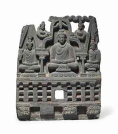 A gray schist frieze of Buddha with Attendants Gandhara, 2nd/3rd century 16 ¼ in. (41 cm.) high