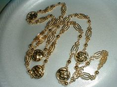 st.john 22 kt gold plated logo necklace by qualityvintagejewels, $199.00