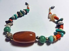 Boho style native American made multi-color beaded bracelet. Mixed semi precious stones with turquoise, heishi and green, white, black, orange and silver beads. Probably Santo Domingo. Working barrel clasp. Purchased at the state fairgrounds flea market in Albuquerque New Mexico. - condition - never worn, stored all these years. - measurements - 7 3/4 total length - marks - unmarked   more vintage jewelry items at susiesboutiquecloths: https://www.etsy.com/shop/susie...