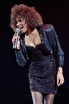 Pin for Later: Remember Whitney Houston With a Look at Her Life in Pictures  Whitney performed in 1988 in Paris.