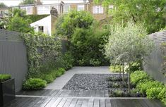 This must be taken in as a whole - click through - great combos & contrast! ----  jet-black-garden-london-townhouse-backyard-gardenista