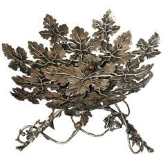 Stephen Dweck sterling leaf dish with leaves and beetles.