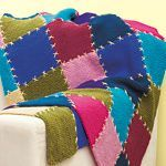 This bright blanket is made from colourful knitted squares that are quick to make and portable, too.