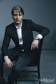 Mads Mikkelsen, looking good as usual, in a chair.