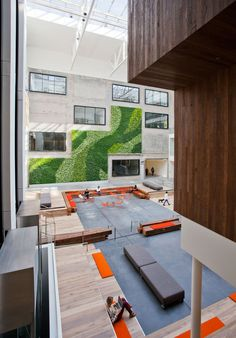 Airbnb's Office Atrium Interior. The green shrubbery wall really livens the space up!