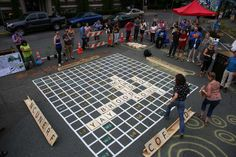 Mega-Scrabble in Seattle: Good luck hiding your tiles here. This #LQC project went the extra step and added programming to the mix, organizing an eight-team tournament to raise awareness of the First Hill neighborhood's wasted public space opportunities. #Placemaking #GiantGames