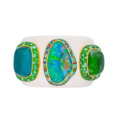 """This magical cuff with this mesmerising Australian Opal from Lightning Ridge flanked by two enormous tourmaline is truly wearable art! I love cuffs because every time you look down you are able to enjoy the beauty! I say that there are days of the week when fab earrings and a """"here I come"""" cuff are just about all you need!! #australianopal #australiandesigner #oneofakindjewelry #preciousjewels #cuffs #opaljewelry #hautejoaillerie #unique #australiandesigner #margotmckinneyjewellery…"""
