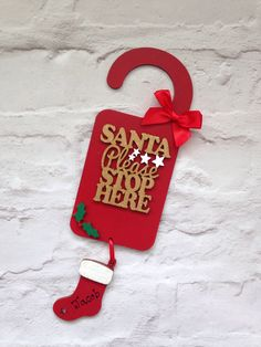 A personal favourite from my Etsy shop https://www.etsy.com/uk/listing/525399900/santa-please-stop-here-personalised