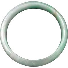The color of the jade used in this bangle is a very nice light green with beautiful soft splashes of fine darker green inclusions. The polish is soft