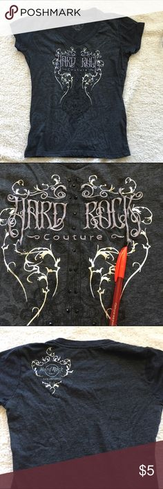 Hard Rock Couture v-neck t-shirt, Sz S Hard Rock Couture gray v-neck t-shirt with black rhinestone embellishments. A little bit of the embroidery detail is loose (picture 2). The back left shoulder has the logo Hard Rock Cafe San Antonio. Good used condition. Hard Rock Couture Tops Tees - Short Sleeve