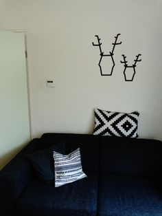 Deers made out of masking tape on the wall!