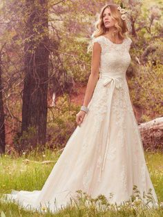 Maggie Sottero - lindsey marie, Featuring cascades of lace appliqués, this tulle A-line wedding dress evokes understated elegance with demure cap-sleeves, a jewel neckline, and lush godets in the gown's skirt. Finished with covered buttons over zipper and inner elastic closure. Style includes detachable grosgrain belt.