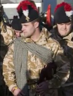 Royal Regiment of Fusiliers piper wearing the Northumberland tartan