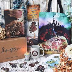Time for my @shelflovecrate Enchanted Journeys unboxing!! This box was awesome  CONTENTS ADSOM Tarot cards (available now in the @shelflovecrate shop) by @dianadworak Canvas Prythian map by @inkandwonder.designs The Fellowship candle by @biblioflames The Wizard of Oz tote bag by @eviebookish Compass mug by Intuerito Raven postcard An Enchantment of Ravens by @margaret_rogerson  Isnt this box fantastic?  #bookishmerchfeatures #bookishmerch #bookstagram #ilovebooks #readersofinstagram…