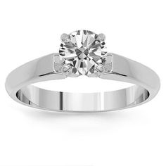 Simple solitaire engagement ring is prong set with one small round cut