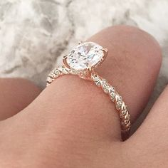 This rose gold A.JAFFE engagement ring features a tightly twisted diamond shank and an oval center stone. Style MES867