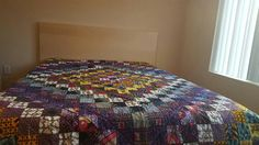 Quilt for J and O.  African fabrics used for there wedding.