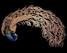 """For the Exposition Universelle de Paris in Mellerio dits Meller presented 12 pieces based on the peacock. Here is the """"Paon Royal"""" headdress, which was made in gold and platinum with cloisonné and diamonds. Bijoux Art Nouveau, Art Nouveau Jewelry, Jewelry Art, Antique Jewelry, Jewelry Accessories, Vintage Jewelry, Fine Jewelry, Jewelry Design, Gold Jewelry"""