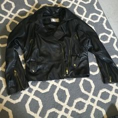 100% real leather Moto jacket Real leather motorcycle jacket. Amazing condition black really soft multiple pockets on the front and zippers on the sleeves size. Hardware in gold. small but can fit a large from Henri Bendel New York. Make an offer. henri bendel Jackets & Coats