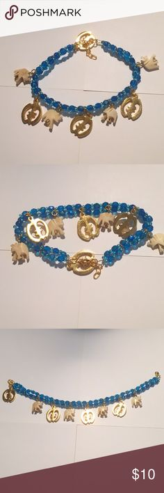 Beautiful turquoise beads ankle bracelet 💙🐘💙 Beautiful turquoise beads ankle bracelet with 4 cute plastic elephants & 4 gold round design. Is 10.3 inches long & 4. Wide when you put it on it goes all the way down. Wide look. Very sexy and pretty. Is cosmetic jewelry . Not real . NWOT never used. Just put it on for picture . Any questions feel free to ask me 💙🐘💙 Ashro Accessories