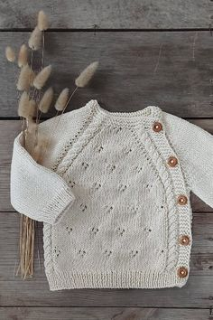 Hand knitted newborn coming home outfit. 100% organic cotton. This gender neutral clothing set includes sweater, pants, bonnet and footies. Made of superior, ultra soft organic cotton. It keeps your baby warm without sweating thanks to its breathable fabric. Available in off-white, dusty pink and pale blue. #cominghomeoutfit #newbornoutfit #babygirloutfit #babyboyoutfit #babyknits #organicbabyproducts #babygirlstyle #pregnancydiary #babygirlstyle #babyshowergifts #babyclothes #genderneutral  Newborn Coming Home Outfit, Baby Boy Knitting, Baby Warmer, Baby Boy Newborn, Baby Sweaters, Baby Girl Fashion, Dusty Pink, Gender Neutral, Baby Boy Outfits