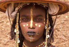 Africa | Wodaabe man participating in the Yaake dance during the Gerewol festival. Niger | ©Michel Renaudeau