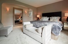 The master bedroom has silk wall covering in the clients' favourite taupe and silver colours