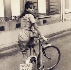Leslie Caron biking in Paris // Vintage bikes had license plates?