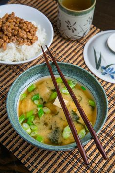 Japanese miso soup with tofu and wakame (an edible seaweed), served with a bowl of rice topped with nattou
