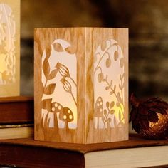 How adorable is this wood papercut lantern for fall?! We have the SVG and PDF for you on our site!  #diyhomedecor #handcraftyourlife #papercut @officialcricut @etc.papers