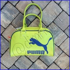 """PUMA HERITAGE HANDBAG This classic handbag has a long history and bright future,. The straightforward design and spacious interior will have you reaching for it day and night. Durable construction 100% PU, two way zip opening into large compartment, internal padded sleeve for iPad , internal zip pocket and slip-in pockets,  tote carry handles, structural contrast piping, puma logo on face. Approx 15"""" x 9"""" x 6"""" Puma Bags"""