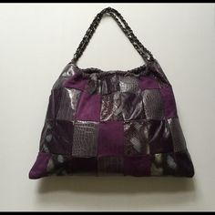 """Purple Patchwork Hobo Bag Fashion forward•unique•a must have•large bag•faux leather and suede•measures 18"""" wide 15"""" long• 2 detailed metal chain straps measures 19"""" each•snap inside•closure•three inner pockets two open one zipped•fabric lining•gently loved•no flaws. Bags Hobos"""