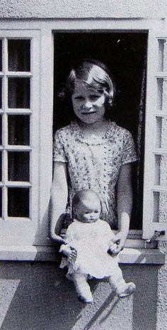 Queen Elizabeth II as a young girl with her doll in the 1930s